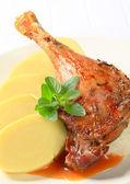 Roast duck with potato dumplings and sauerkraut — Stock Photo