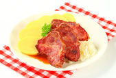 Pork with potato dumplings and sauerkraut — Stock Photo