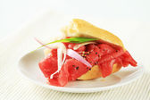 Baguette with beef Carpaccio — Stock Photo