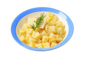 Plate of diced potatoes — Stock Photo