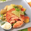 Seared salmon patty with vegetables - Stock Photo