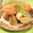 Fried fish with new,potatoes - Stock Photo