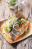Pan fried trout with green salad — Stock Photo