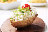 Baked potato and cheese — Stock Photo