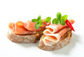 Prosciutto open faced sandwiches — Stock Photo