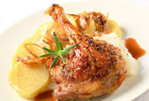 Roast duck with potato dumplings and white cabbage — Stock Photo