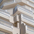 Balconies with white balustrades - Stock Photo