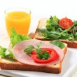 Bread with ham and salad greens — Stock Photo
