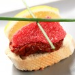 Red caviar canape — Stock Photo
