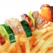 Pork skewer and French fries — Stock Photo