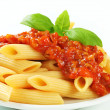 Penne with meat tomato sauce - Stock Photo