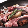 Stock Photo: Lamb chops and mushrooms