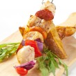 Chicken Shish kebab and potato wedges — Stock Photo