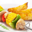 Shish kebab and potato wedges — Stock Photo #24754619