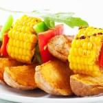 Shish kebab and potato wedges — Stock Photo #24754629