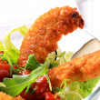 Crispy chicken tenders with salad - Stock Photo
