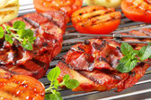 Grilled pork steaks and vegetables — Stock Photo