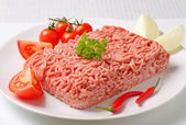 Raw ground pork and vegetables — Stock Photo