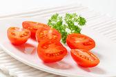 Halved plum tomatoes — Stock Photo