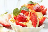 Creamy pudding with fresh fruit — Stock Photo