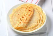 Stack of crepes on plate — Stock Photo