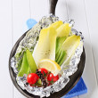 Fresh vegetables on tinfoil in skillet — Stock Photo