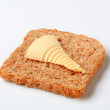 Brown bread and butter — Stock Photo