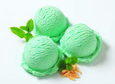 Scoops of green ice cream — Stock Photo