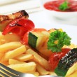 Vegetable skewer and French fries — Stock Photo