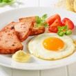 Stock Photo: Pan-fried Leberkase with sunny side up fried egg