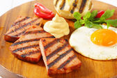 Grilled Leberkase with fried egg and mustard — Stock Photo