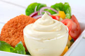 Fried cheese with vegetable salad and mayonnaise — Stock Photo