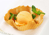 Orange sherbet in a waffle basket — Stock Photo