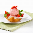 Ice cream and strawberries in waffle basket — Stock Photo