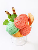 Fruit sherbets in ice cream coupe — Stock Photo