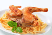 Crisp-skinned chicken with French fries — Stock Photo