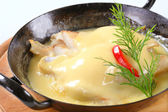 Pan seared fish with thick cheese sauce — Stock Photo