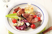 Pork skewer with vegetables — Stock Photo