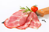 Thin slices of smoked pork — Stock Photo