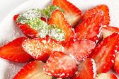 Fresh strawberries with icing sugar — Stock Photo