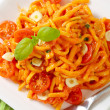 Spaetzle in garlic tomato sauce — Stock Photo