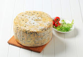 Wheel of blue cheese — Stock Photo