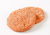 Raw burger patties — Stock Photo