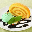 Stock Photo: Swiss Roll with scoop of green sherbet