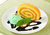 Swiss Roll with scoop of green sherbet — Stock Photo