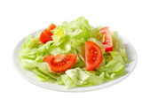 Ice lettuce and tomato wedges — Stock Photo