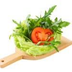 Rocket salad in lettuce bowl — Stock Photo