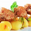 Meatball skewer and potatoes — Stock Photo