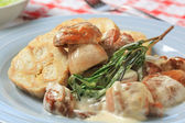 Porcini mushrooms in cream sauce and dumplings — Stock Photo