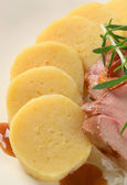 Pork with potato dumplings and white cabbage — Stock Photo